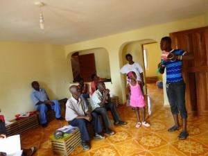 The Water Project : sierraleone5061-100-clean-teeth-teacher-teaching-back