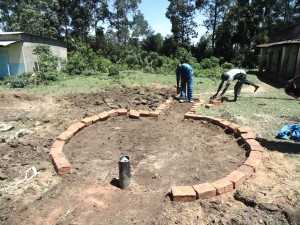 The Water Project : kenya4453-22-ematoyi-market-well-pad-construction