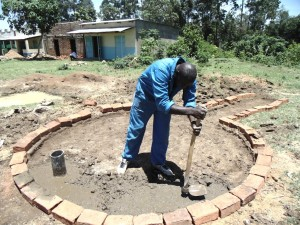 The Water Project : kenya4453-24-ematoyi-market-well-pad-construction