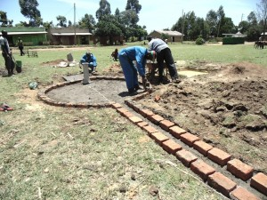 The Water Project : kenya4453-25-ematoyi-market-well-pad-construction