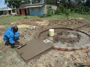 The Water Project : kenya4453-26-ematoyi-market-well-pad-construction