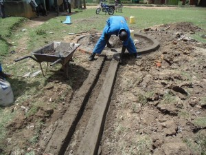 The Water Project : kenya4453-27-ematoyi-market-well-pad-construction