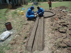 The Water Project : kenya4453-28-ematoyi-market-well-pad-construction