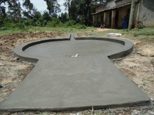 The Water Project : kenya4453-29-ematoyi-market-well-pad-construction
