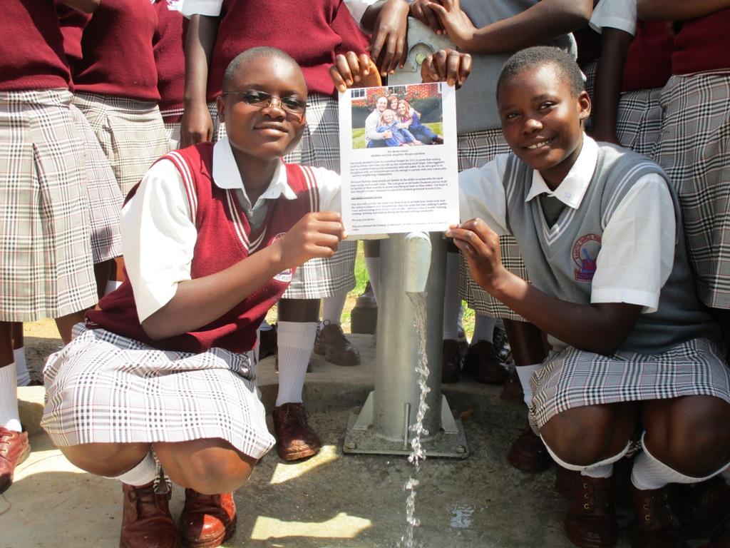 The Water Project : samitsi-girls-handing-over-13