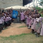 The Water Project: Lubao Primary School Rainwater Harvesting Tank And VIP Latrines -