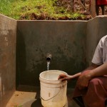 The Water Project: Janepher Opanda Spring Protection and Sanplats -