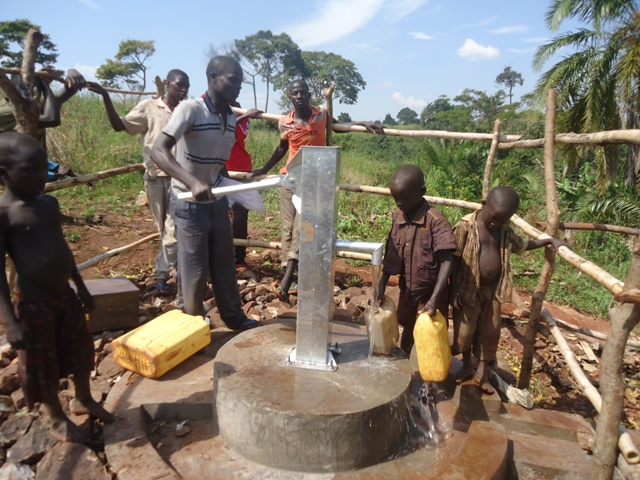 The Water Project : uganda6064-21-pumping-water