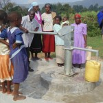 The Water Project: Kimanget Well Rehabilitation Project -  Water Flowing