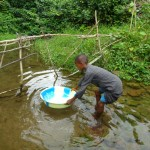 The Water Project: Kasongha Community, 3A Nahim Drive -  Alt Water Source Fetching Water