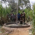 The Water Project: Kakoyi Well Rehabilitation Project -  Flushing