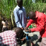 The Water Project: Kakoyi Well Rehabilitation Project -  Pump Installation