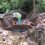 The Water Project: Kavehere Spring Protection Project -  Construction