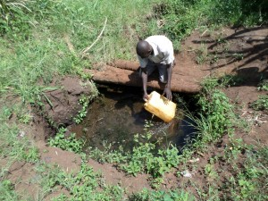 The Water Project : 2-uganda6070-open-water-source