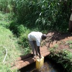The Water Project : 4-uganda6070-open-water-source