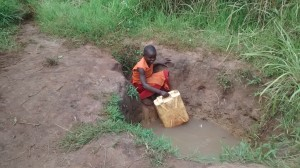 The Water Project : 5-uganda6072-fetching-water