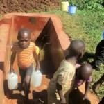 The Water Project: Emmabwi Primary School -  Boys Fetch Water After School