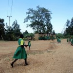 The Water Project: Mahanga Primary School -  Girls Rushing To Latrines