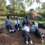 The Water Project: Matsigulu Friends Secondary School -  Students Relax On Rocks