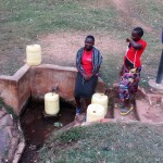 The Water Project: Bumuyange Secondary School -  Josephine And Angella Fetch Water From Wandezwa Spring