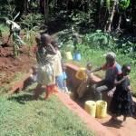 The Water Project: Emmabwi Primary School -  Community Members Fetch Water
