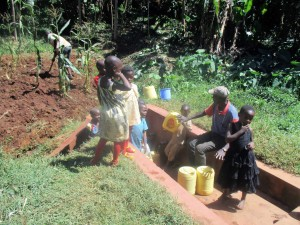 The Water Project:  Community Members Fetch Water