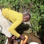 The Water Project: Shitungu Community -  Woman Fetching Water