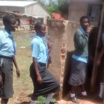 The Water Project: Ebukanga Secondary School -  Girls Waiting For Latrines