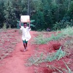 The Water Project: Kidinye Community A -  Carrying Water