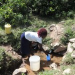 The Water Project: Shitungu Community A -  Fetching Water