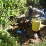 The Water Project: Shitungu Community -  Scooping Water