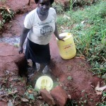 The Water Project: Emabungo Community -  Fetching Water