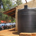 The Water Project : 5-kenya4667-plastic-tank-and-lunch-line
