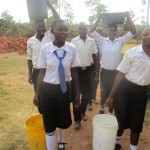 The Water Project: Bumira Secondary School -  Fetching Water From The Primary Section