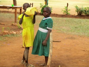 The Water Project:  Pupil Drinking From Her Container