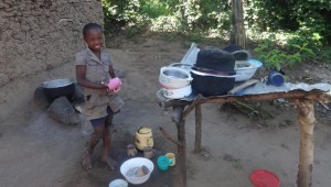 The Water Project:  Shanila Poses Before Her Improvised Dish Rack