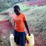 The Water Project: Kidinye Community, Wamwaka Spring -  Carrying Water