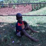 The Water Project: Nyira Community, Ondiek Spring -  Elvis Eating A Wet Maize Stalk Since His Parents Cannot Afford Lunch