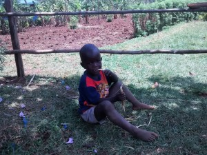 The Water Project : 1-kenya4719-elvis-eating-a-wet-maize-stalk-since-his-parents-cannot-afford-lunch