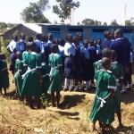 The Water Project: Kalenda Primary School -  Girls Waiting To Use Latrine