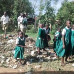 The Water Project: Essaba Primary School -  Children Playing Around Garbage