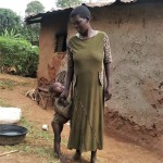 The Water Project : 13-kenya4709-rachel-and-her-son-pose-outside-their-household