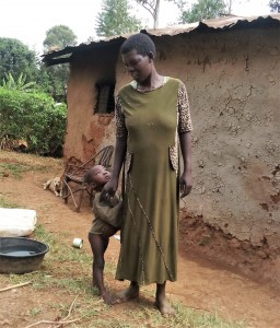 The Water Project:  Rachel And Her Son Pose Outside Their Household