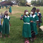 The Water Project: Kalenda Primary School -  Eating Porridge