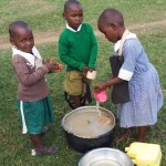 The Water Project: Kalenda Primary School -  Washing Porridge Cups