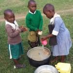 The Water Project : 15-kenya4657-washing-porridge-cups