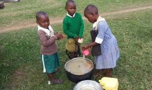 The Water Project : 15-kenya4657-washing-porridge-cups