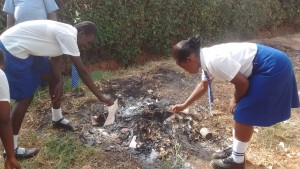 The Water Project:  Burning Waste
