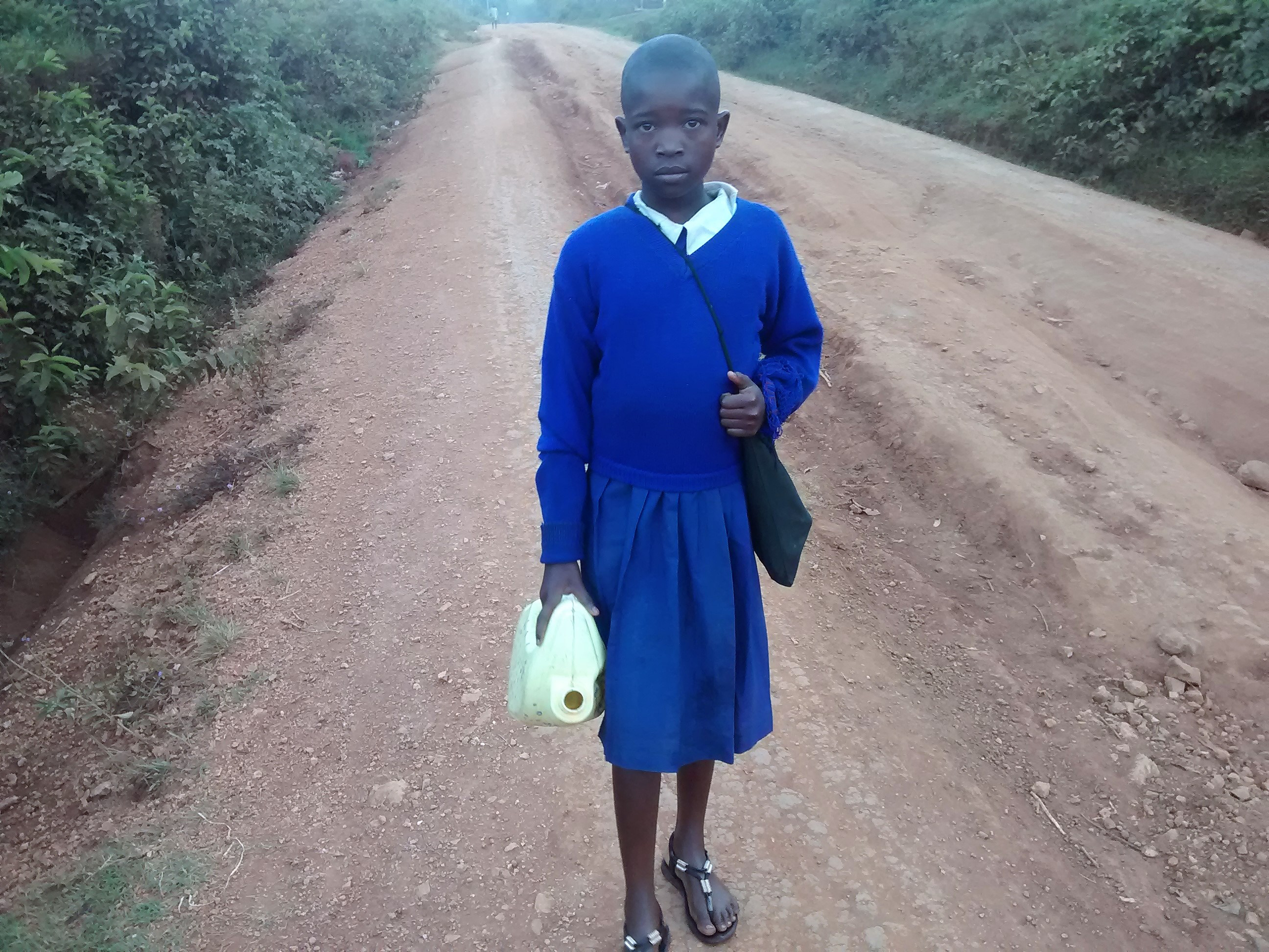 The Water Project : 3-kenya4654-girl-carrying-water-to-school