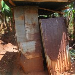 The Water Project: Nyira Community, Ondiek Spring -  Latrine Made From Iron Sheets